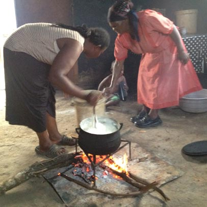 Women cooking a meal in rural Swaziland